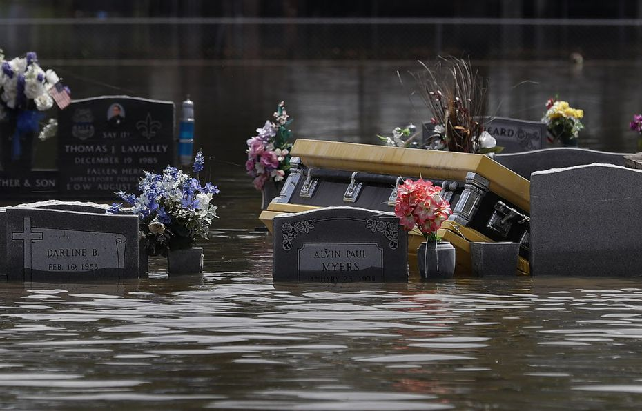 A casket is seen in a flooded cemetery on Aug. 17, 2016, in Sorrento, La. Tremendous downpours have resulted in disastrous flooding, responsible for at least 13 deaths and thousands of homes being damaged.