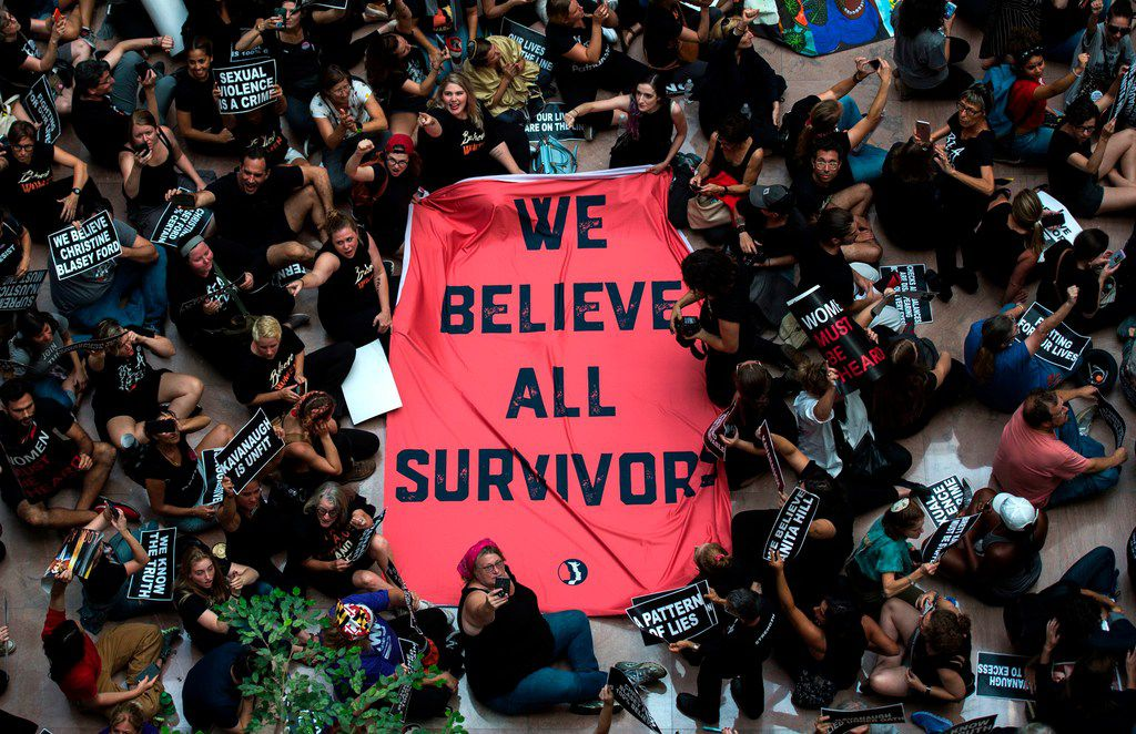"""TOPSHOT - Protesters unfurl a sign as they occupy the Senate Hart building during a rally against Supreme Court nominee Brett Kavanaugh on Capitol Hill in Washington, DC on October 4, 2018. - Top Republicans voiced confidence Thursday that Brett Kavanaugh will be confirmed to the US Supreme Court this weekend, as they asserted that an FBI probe had found nothing to support sex assault allegations against Donald Trump's nominee.""""Judge Kavanaugh should be confirmed on Saturday,"""" Senator Chuck Grassley of Iowa, the chairman of the Senate Judiciary Committee, told reporters. (Photo by ANDREW CABALLERO-REYNOLDS / AFP)ANDREW CABALLERO-REYNOLDS/AFP/Getty Images"""