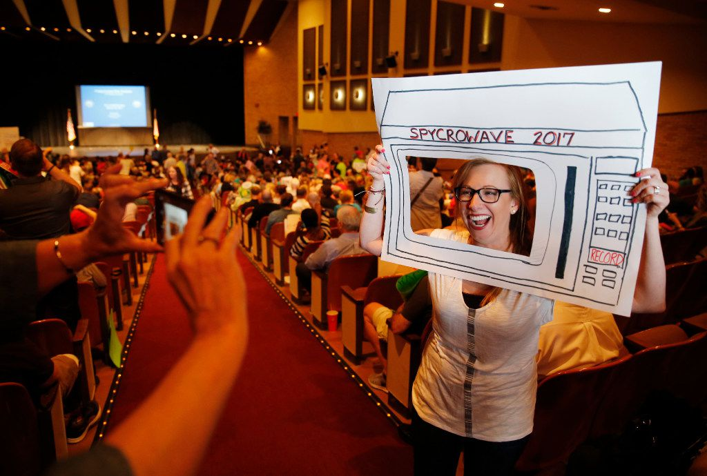 Alicia Coddington of Rowlett gets her photo taken before the start of a town hall meeting with Rep. Pete Sessions, R-Dallas, in the auditorium of Richardson High School on Saturday. (Vernon Bryant/The Dallas Morning News)
