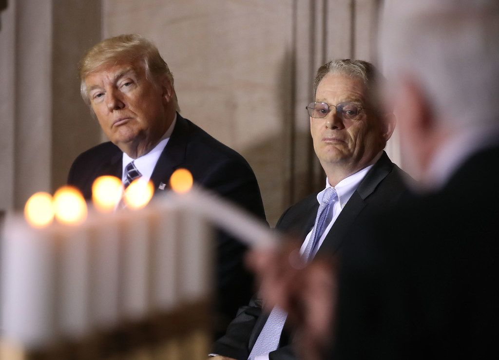 """WASHINGTON, DC - APRIL 25: U.S. President Donald Trump and Tom Bernstein, (R) Chairman of the U.S. Holocaust Memorial Museum watch as cables are lit during the museum's """"Days of Remembrance"""" ceremony at the U.S. Capitol building, on April 25, 2015 in Washington, DC.  (Photo by Mark Wilson/Getty Images)"""