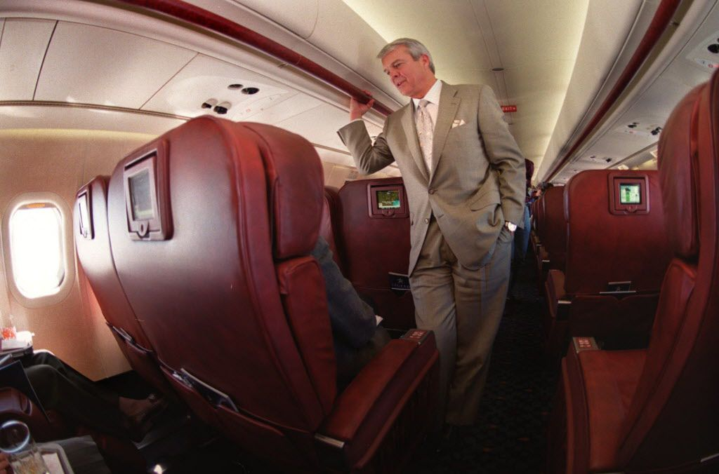 Legend Airlines President and CEO Allan McArtor visiting with a passenger on a flight to Washington, D.C., during the airline's short-lived time in the sky.