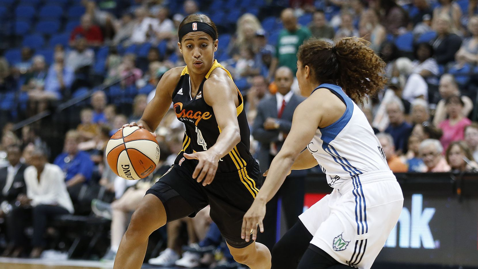 In this June 21, 2015, file photo, Tulsa Shock guard Skylar Diggins (4) drives the ball around Minnesota Lynx guard Jennifer O'Neill during a WNBA basketball game in Minneapolis. (AP Photo/Stacy Bengs, File)