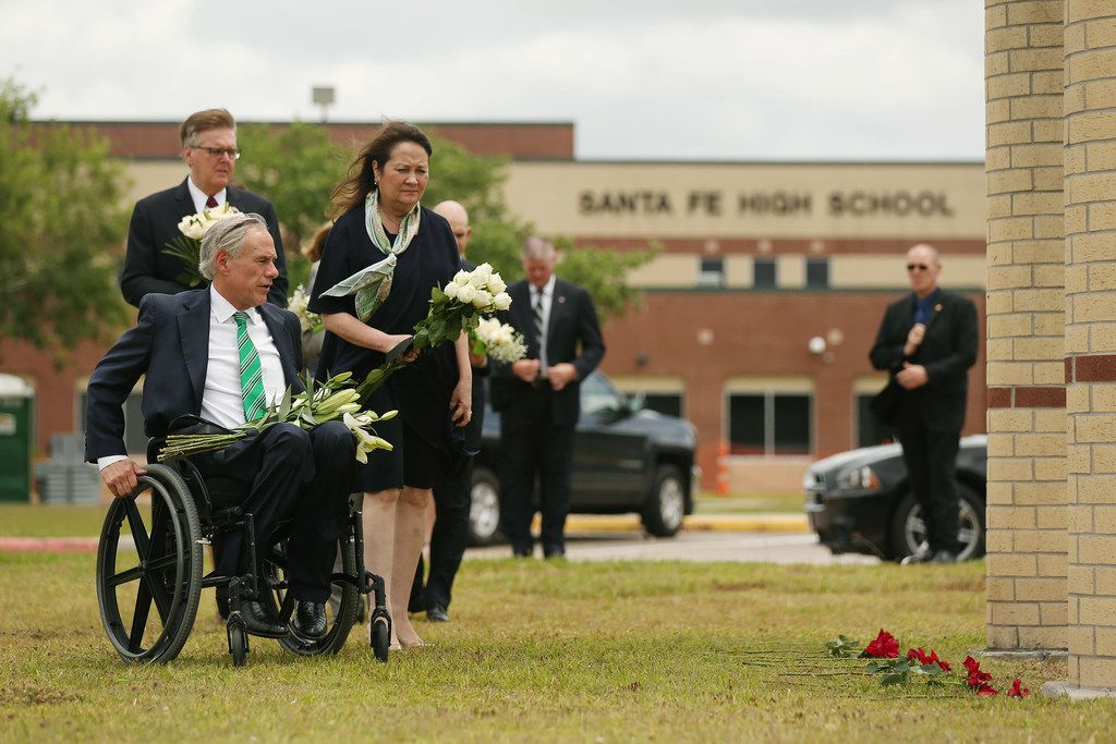 Texas Gov. Greg Abbott and his wife, Cecilia Abbott, arrived at Santa Fe High School with Lt. Gov. Dan Patrick to lay flowers at the school in Santa Fe, Texas, on May 20, 2018. On May 18, 10 people were killed and 13 were injured in a shooting at the school.