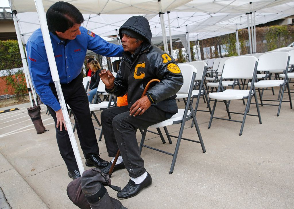David Timothy, also known as SoupMan, hugged Daniel Rodriguez and asks him about an upcoming eye surgery before worship service at the SoupMobile Church for the homeless in Dallas on Feb. 4, 2018.