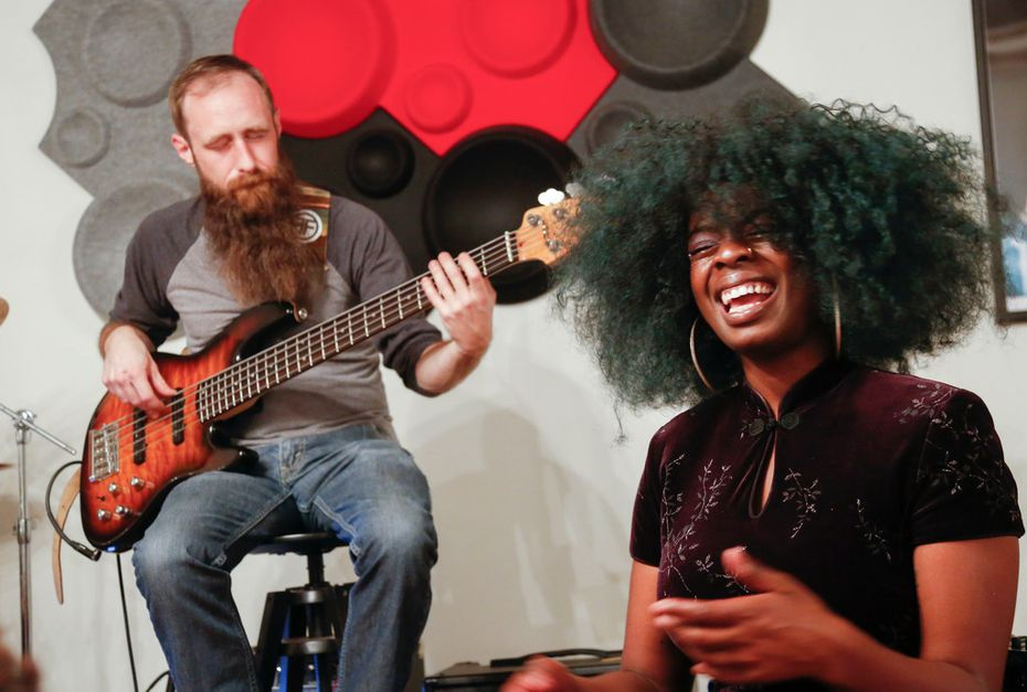 M3cca, on right, performs with bass guitarist Wade Campbell.