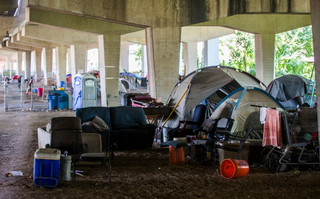 Tents are set up in a homeless encampment under Interstate 30 at Haskell Avenue on Thursday, September 8, 2016 at in Dallas.  (Ashley Landis/The Dallas Morning News)