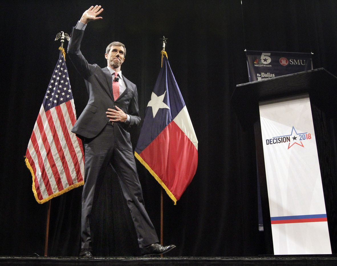 Rep. Beto O'Rourke (D-TX) waves to his supporters as he takes the stage to debate Sen. Ted Cruz (R-TX) in McFarlin Auditorium at SMU in Dallas, Friday, September 21, 2018.