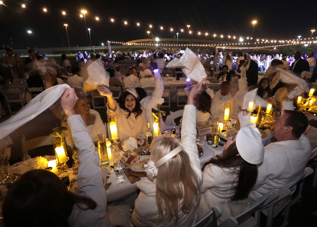 Guests enjoy a secret Diner en Blanc event at Reunion Park in Dallas, TX, on Nov. 9, 2018. (Jason Janik/Special Contributor)