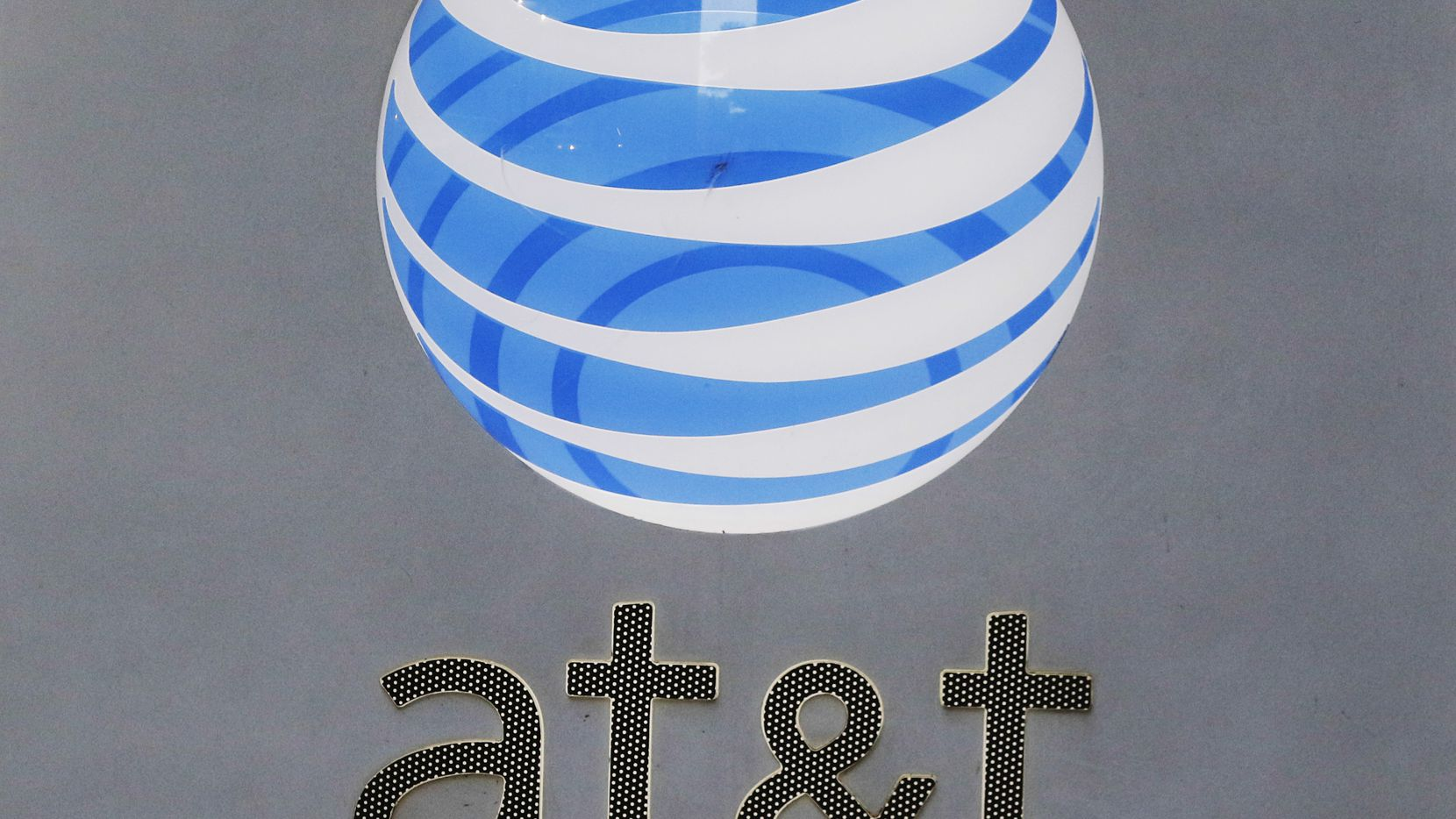 AT&T signage at its corporate headquarters in downtown Dallas. (David Woo/The Dallas Morning News)