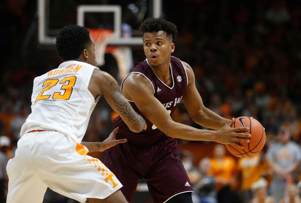 Texas A&M guard Admon Gilder (3) is defended by Tennessee guard Jordan Bowden (23) during the second half of an NCAA college basketball game Saturday, Jan. 13, 2018, in Knoxville, Tenn. (AP Photo/Crystal LoGiudice)