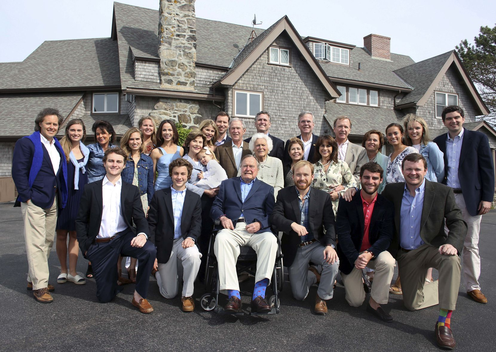 The Bush family poses for a photo in June 2015 at the family estate in Kennebunkport, Maine. The family gathered for a gala planned to celebrate Barbara Bush's 90th birthday. Among those present were former President George H.W. Bush, former President George W. Bush, former Florida Gov. Jeb Bush, and their families.