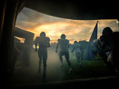 Frisco Lone Star cornerback Sherman Steptoe (16), offensive lineman Braden Grove (55) and wide receiver Marvin Mims (18) takes the field to face Highland Park in a high school football game as the sun sets on Highlander Stadium on Friday, Sept. 13, 2019, in Dallas. (Smiley N. Pool/The Dallas Morning News)