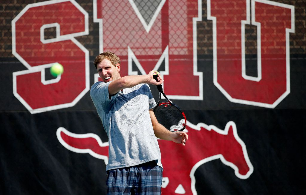 Dallas Mavericks forward Dirk Nowitzki returns the ball while practicing with Grand Slam doubles champ Mark Knowles at the SMU Tennis Center in Dallas, Thursday, Sept. 15, 2016. Andy Roddick, Ben Stiller, John Isner, Benjamin Becker, mark Knowles, Boris Kodjoe, J.J. Barea, Harrison Barnes and Mitchell Krueger are on the list of participating players at the Dirk Nowitzki Pro Celebrity Tennis Classic. (Jae S. Lee/The Dallas Morning News)