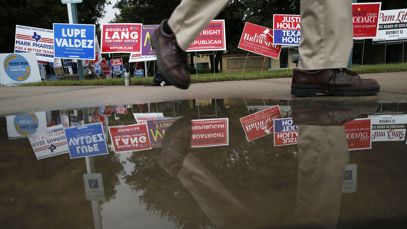 A voter made his way back to his car after voting at a polling station at Collin College Preston Ridge Campus in Frisco on Oct. 25.