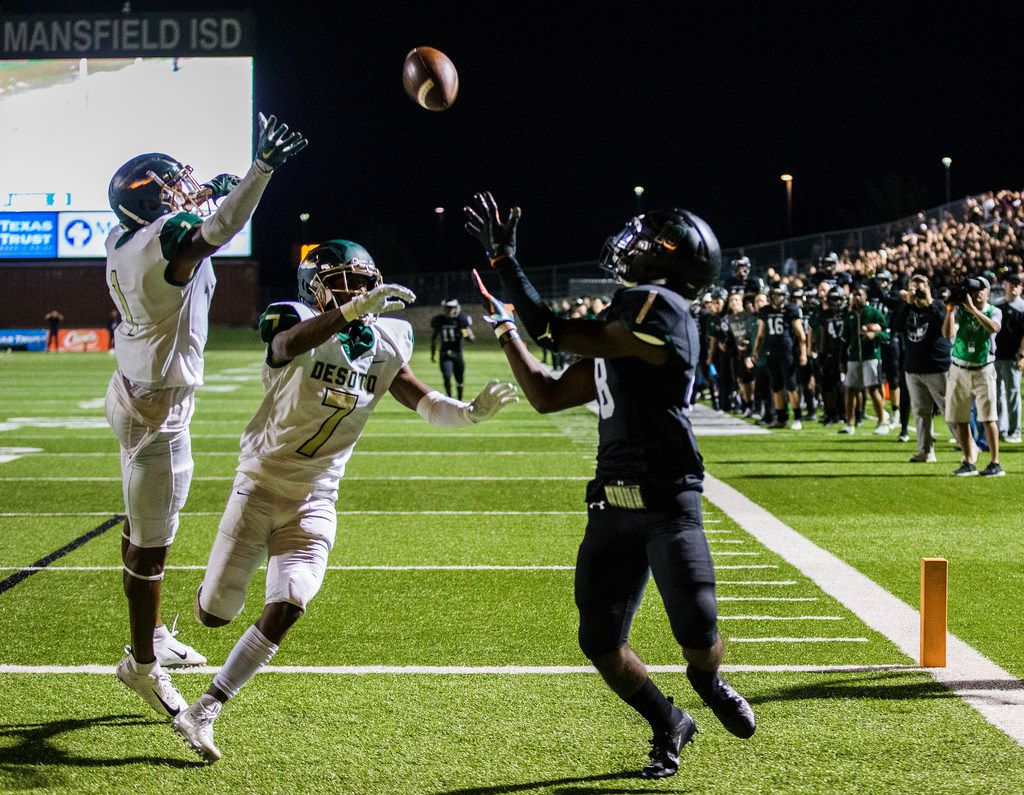 Mansfield Lake Ridge wide receiver Keylan Johnson (18) catches a pass in the end zone for a touchdown to win a District 7 6A high school football game between DeSoto and Mansfield Lake Ridge on Thursday, September 27, 2018 at Vernon Newsom Stadium in Mansfield, Texas. Defending is DeSoto wide receiver Vontae Chenault (1) and DeSoto defensive back Jabbar Muhammad (7). Mansfield Lake Ridge won 34-29. (Ashley Landis/The Dallas Morning News)