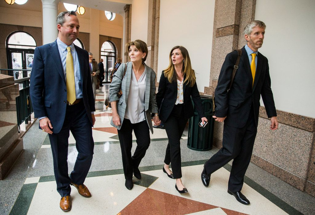 Margo Williams and her daughter, Eve Wiley,  walked with their advisers, Kris Heckmann (left) and Justin Keener, after testifying before the Senate Criminal Justice Committee on Wednesday in Austin.