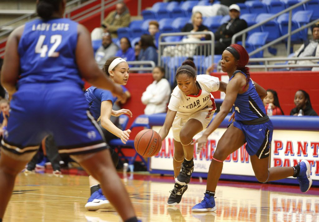 Cedar Hill point guard Dajinae McCarty (1) dribbles between the defense of a couple of Lady Cats from Conway, Arkansas during second half action. The two teams played in the championship game in the Sandra Meadows Classic girls basketball tournament held at the Sandra Meadows Memorial Arena in Duncanville on December 29, 2018. (Steve Hamm/ Special Contributor)