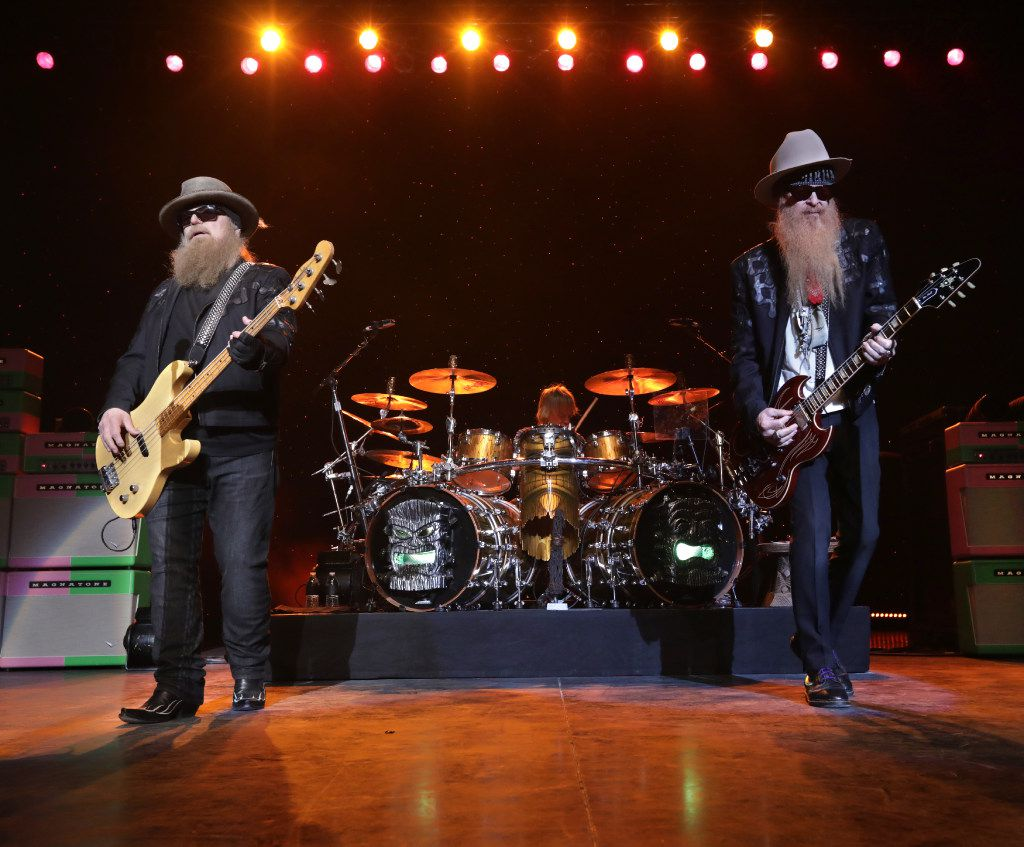 Dusty Hill (left) and Billy Gibbons of ZZ Top perform Saturday at the opening of Toyota Music Factory in Irving.