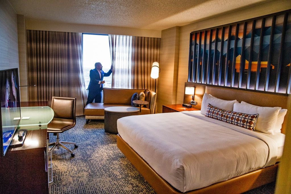 Chris Pilavakis, general manager of Renaissance Dallas hotel, opens window curtains in a newly renovated room at the Renaissance Dallas Hotel on Friday, October 12, 2018.