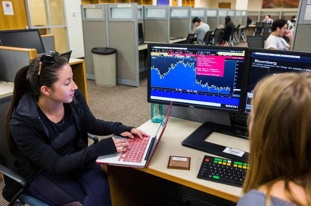 Finance students Christina Petrocelli (left) and Maddie Findlen worked on a group project in the business library at the Cox School of Business on the Southern Methodist University campus in Dallas.