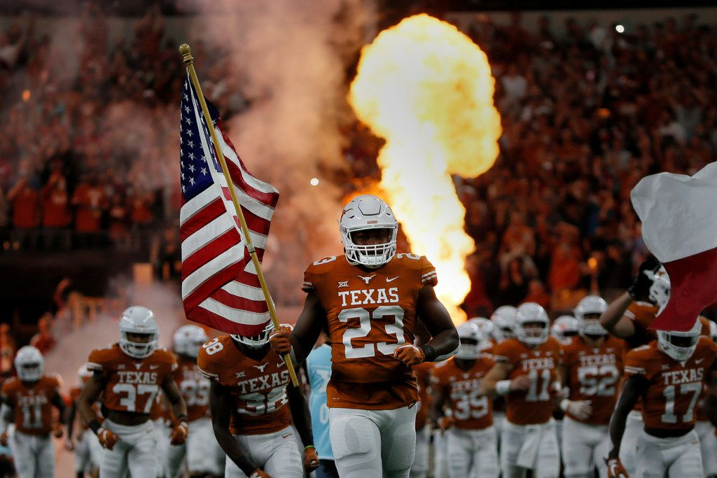 Texas Longhorns Jeffrey McCulloch (23) runs onto the field before the first half of the NCAA Big 12 Conference football championship against the Oklahoma Sooners, Saturday, Dec. 1, 2018, in Arlington, Texas. Oklahoma defeated Texas 39-27. (AP Photo/Roger Steinman)