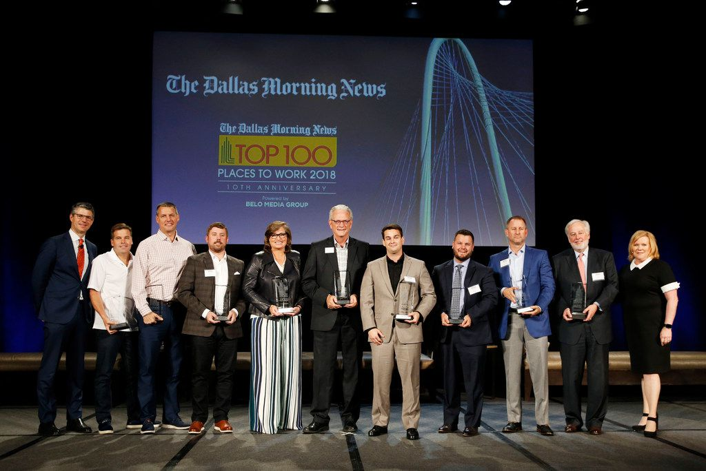 The top nine company winners of 2018 took the stage with their trophies at the luncheon Nov. 1 at the Omni Hotel. From left: DMN publisher and president Grant Moise; Steve Hall, CEO of Driversselect; Todd Wagner, senior pastor of Watermark Community Church; Craig Lashley, president, Valiant Residential; April Anthony, CEO of Encompass Home Health & Hospice: Jim Fite, president and CEO, Century 21 Judge Fite; Josh Harley, CEO, Fathom Realty; Chris Auwarter, president, Evantage Inc.; Paul Camp, vice president of operations and principal, Ridgemont Commercial Construction; Allen Smith, president, SettlePou; and Alison Draper, president of Belo Media Group.