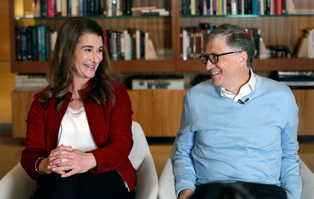 Bill and Melinda Gates look toward each other and smile while being interviewed in Kirkland, Wash. The couple, whose foundation has the largest endowment in the world, are pushing back against a new wave of criticism about whether billionaire philanthropy is a force for good. They said they're not fazed by recent blowback against wealthy giving, including viral moments at the World Economic Forum and the shifting political conversation about taxes and socialism.