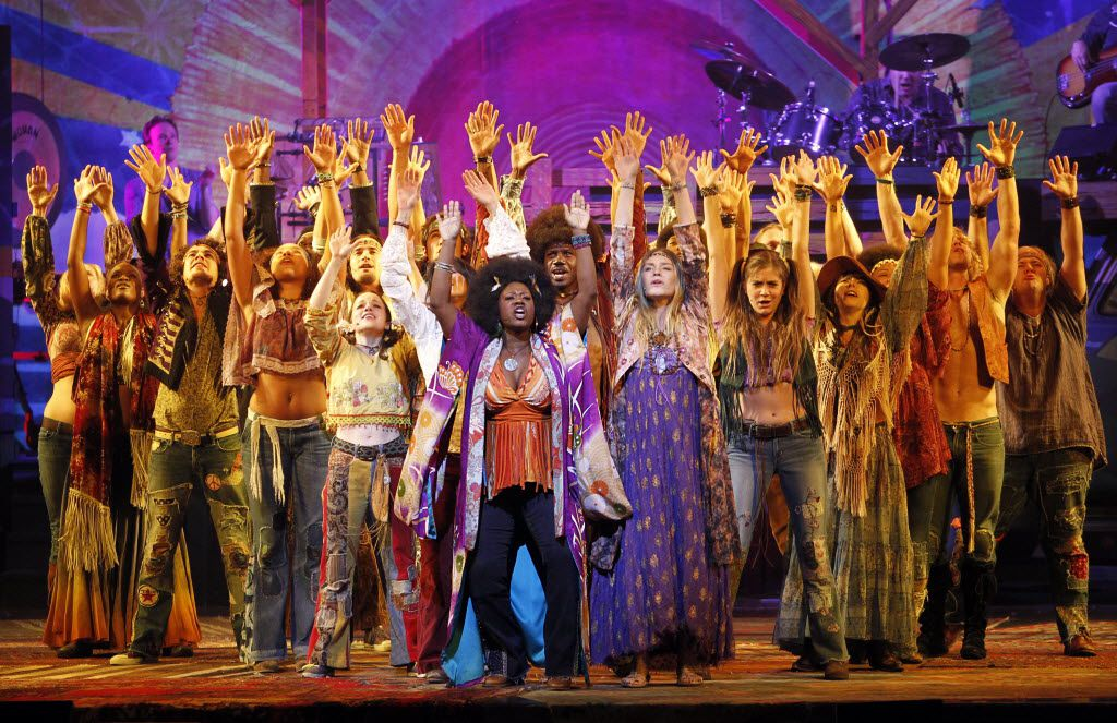 Dionne (Phyre Hawkins, center) leads the opening scene in Hair, The American Tribal Love-Rock Musical, at the AT&T Performing Arts Center on Sept. 20, 2011.