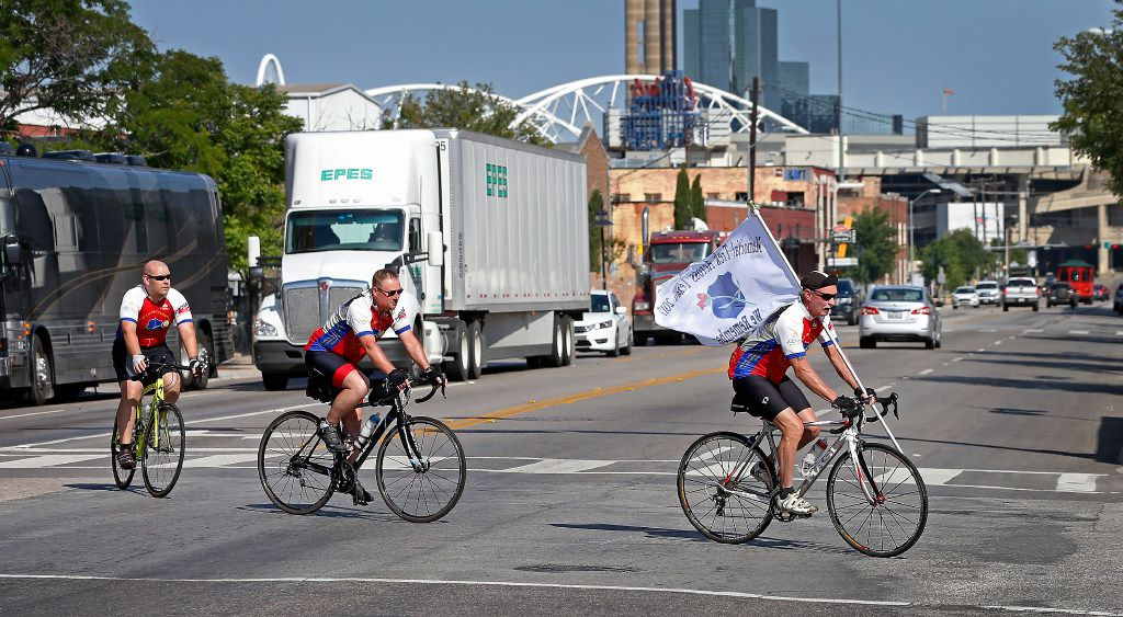 """From left, Officer Joseph Garza, of Corpus Christi Police Department, Sgt. Dayton Neff, of Odessa Police Department, and Harold Hixon, a retired police officer, arrive at the Dallas Police Department headquarters in Dallas, Tuesday, April 25, 2017. Members of the """"We Remember"""" Memorial Bicycle Trek Across Texas made a stop to deliver memorial plaques of the 5 Dallas police officers -- four from DPD and one from DART -- who were killed in the July 7, 2016 ambush attack. (Jae S. Lee/The Dallas Morning News)"""