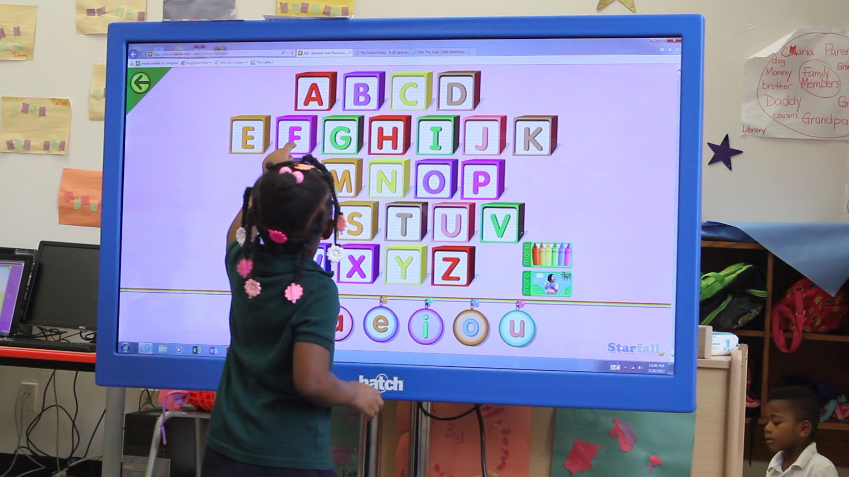 A student at Harllee Early Childhood Center interacts with educational software on a touchscreen computer on Tuesday March 28, 2017.