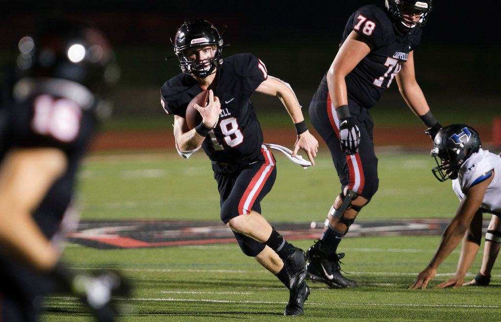 Coppell quarterback  Ryan Walker runs for a first down during the second half of a high school football game against Hebron on Friday, Oct. 4, 2019, in Coppell, Texas. (Smiley N. Pool/The Dallas Morning News)