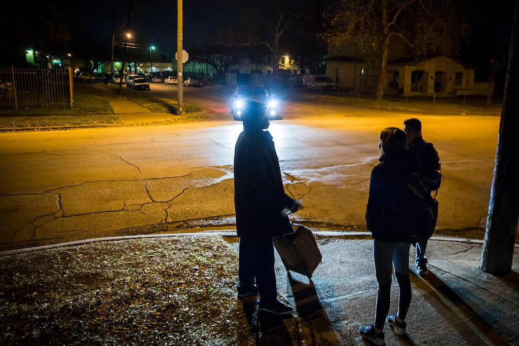 Volunteers Meredith Mortberg  and Alan Garcia (right) interview a homeless man at the corner of Bryan St. and Garrett Ave. during the annual homeless census on Thursday, Jan. 26, 2017, in Dallas.