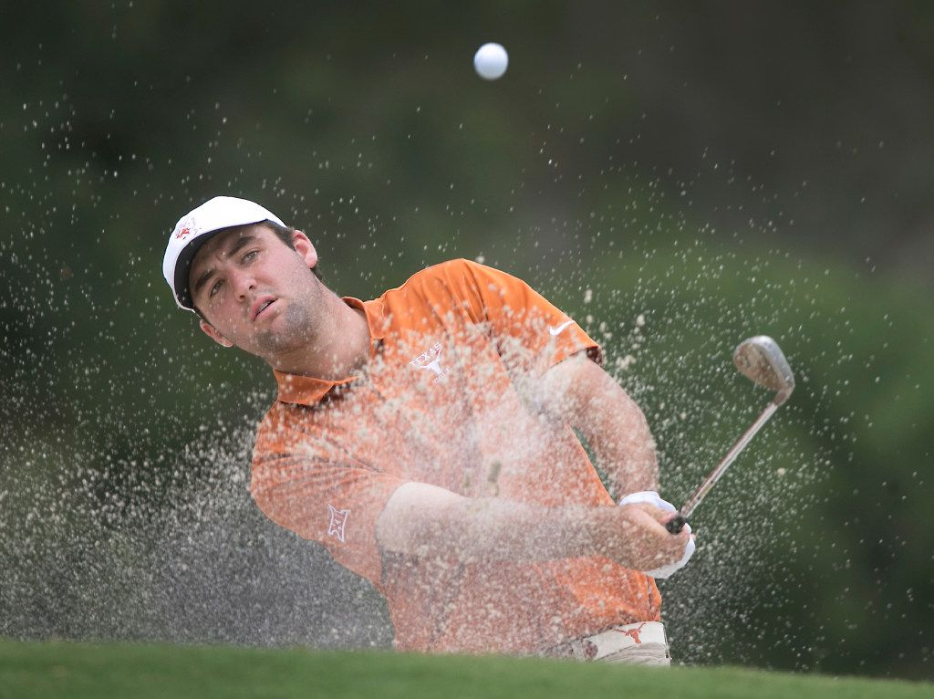 Texas golfer Scottie Scheffler blasts out of the greenside bunker on the par-5 14th hole on his way to a tap-in birdie during the NCAA regional golf tournament against Oklahoma State at the UT Golf Club, Wednesday May 17, 2017, in Austin, Texas. (Ralph Barrera/Austin American-Statesman via AP)