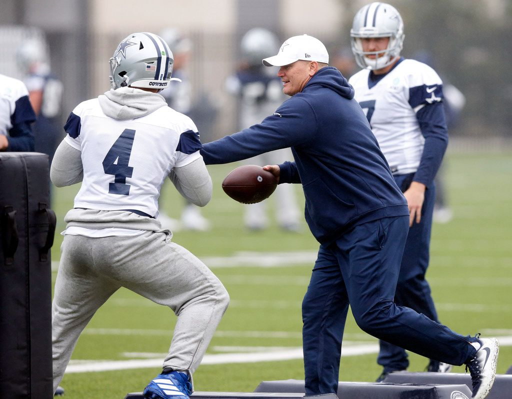 Dallas Cowboys quarterbacks coach Jon Kitna (right) pass rushes quarterback Dak Prescott during practice at The Star in Frisco, Tuesday, October 29, 2019. (Tom Fox/The Dallas Morning News)