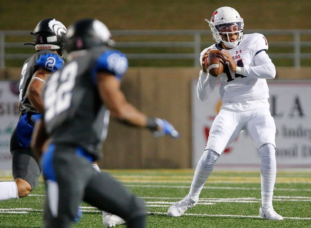 McKinney Boyd High School quarterback Carter Whitefield (14) looks to throw during the first half as Plano West High School hosted McKinney Boyd High School at Clark Stadium in Plano on Friday night, October 11, 2019. (Stewart F. House/Special Contributor)