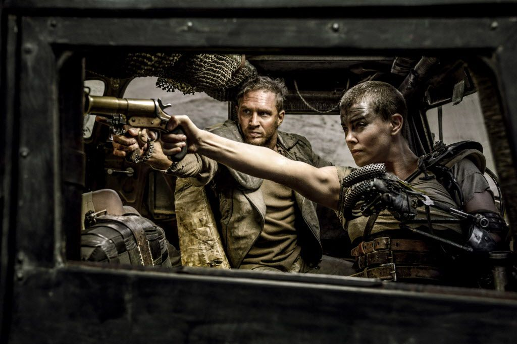 Two smoking barrels:  Tom Hardy and Charlize Theron take aim in  Mad Max: Fury Road.  (Jasin Boland/Warner Bros. Pictures via AP)
