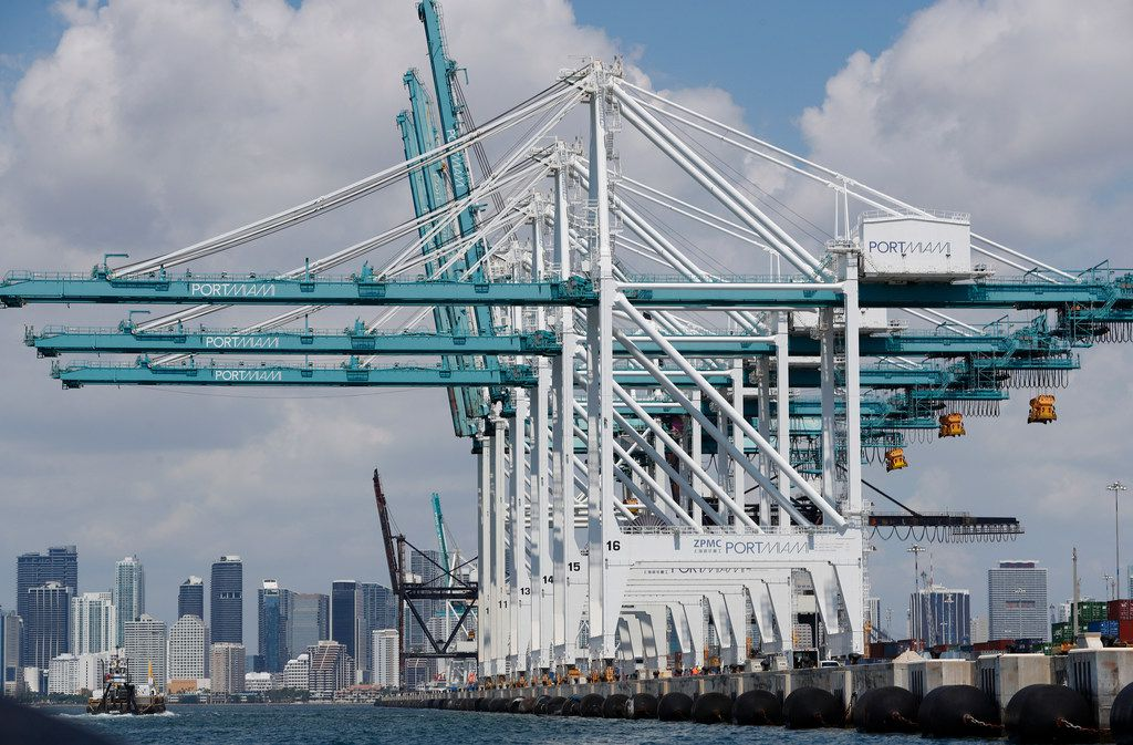 Large cranes wait to unload container ships at PortMiami.