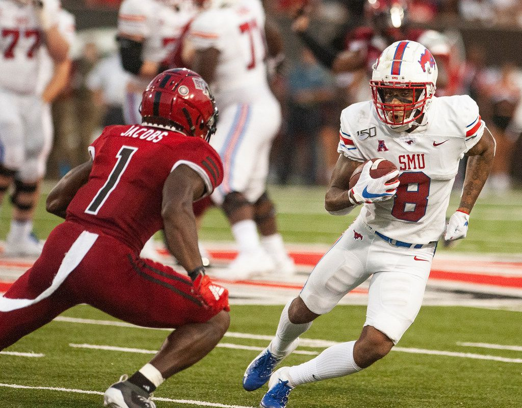 SMU wide receiver Reggie Roberson Jr (8) tries to avoid a tackle attempt by Arkansas State cornerback Jerry Jacobs (1) during the first half of an NCAA college football game Saturday, Aug. 31, 2019, in Jonesboro, Ark. (Quentin Winstine/The Jonesboro Sun via AP)