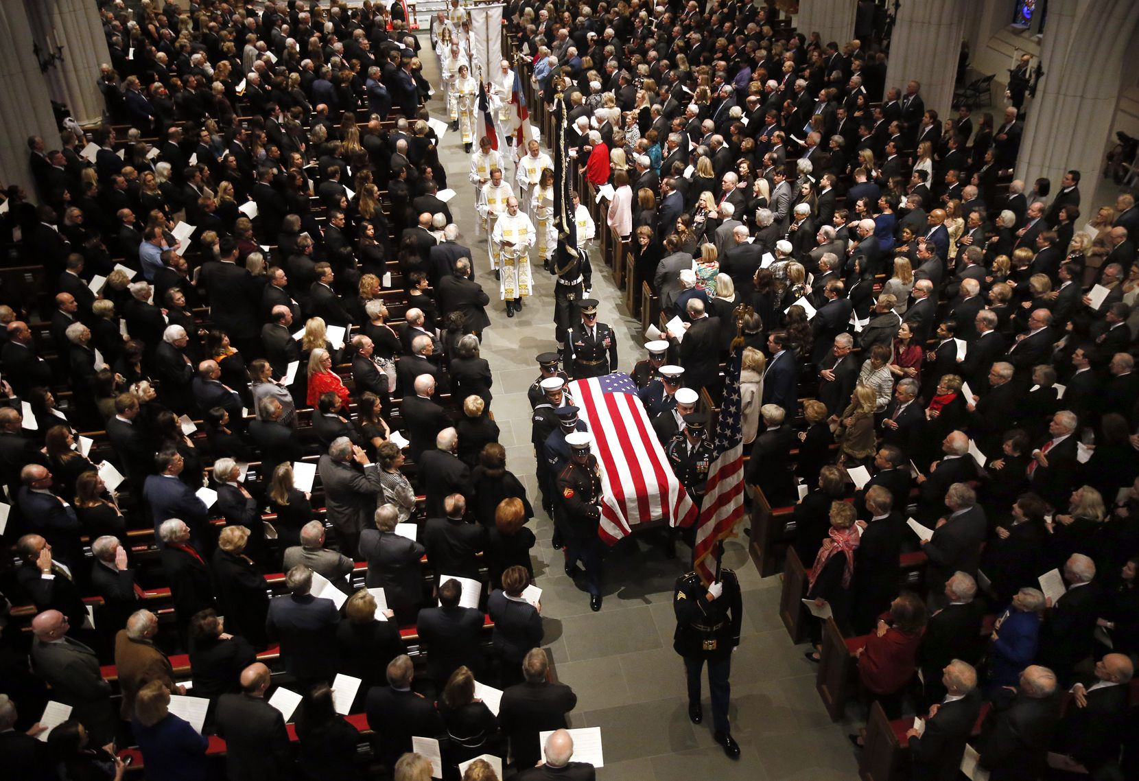Military pallbearers carry the casket of George H.W. Bush, the 41st President of the United States, during the funeral recessional at St. Martin's Episcopal Church in Houston, Thursday, December 6, 2018. (Tom Fox/The Dallas Morning News)