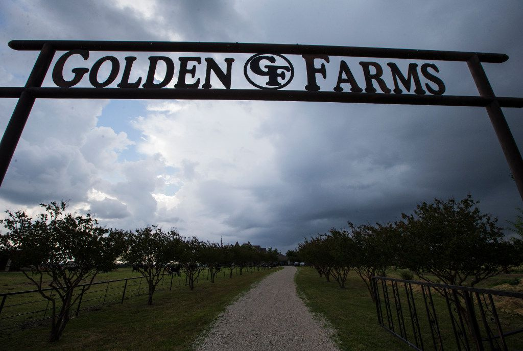 Storm clouds roll past the entrance to Golden Farms.