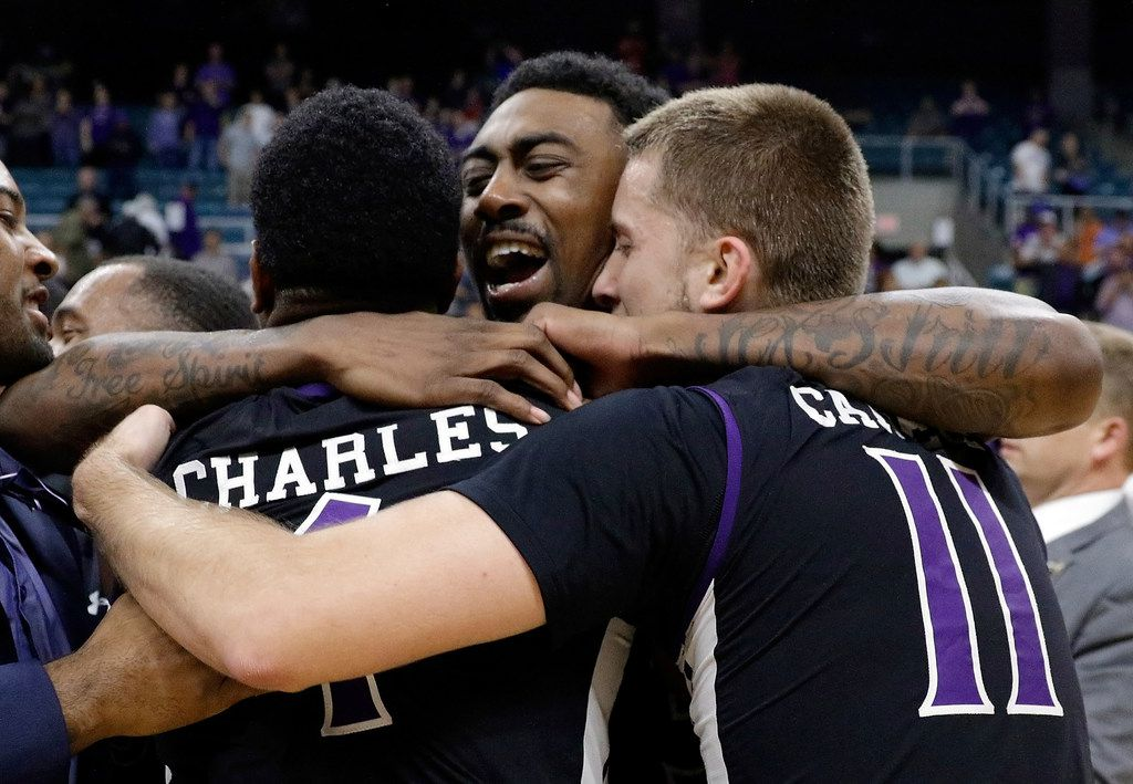 Stephen F. Austin guard Kevon Harris (1), Leon Gilmore III (3) and Ivan Canete (11) embrace after defeating Southern Louisiana after an NCAA college basketball game in the Southland Conference's Men's Basketball Tournament Championship Saturday, March 10, 2018, in Houston. (AP Photo/Michael Wyke)