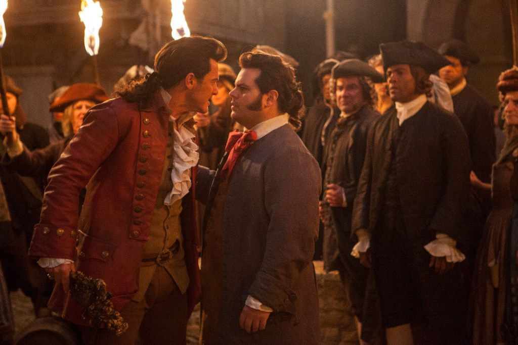 "Luke Evans as Gaston and Josh Gad as LeFou in Disney's ""Beauty and the Beast"" Luke Evans is Gaston and Josh Gad is LeFou, in Disney's BEAUTY AND THE BEAST, a live-action adaptation of the studio's animated classic, directed by Bill Condon."