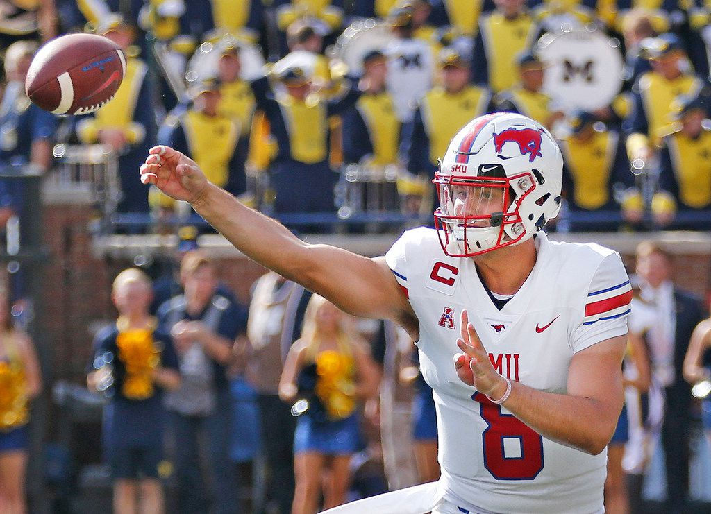 Southern Methodist Mustangs quarterback Ben Hicks (8) throws a pass during the SMU Mustangs vs. the Michigan Wolverines NCAA football game at Michigan Stadium in Ann Arbor, Michigan on Saturday, September 15, 2018. (Louis DeLuca/The Dallas Morning News)