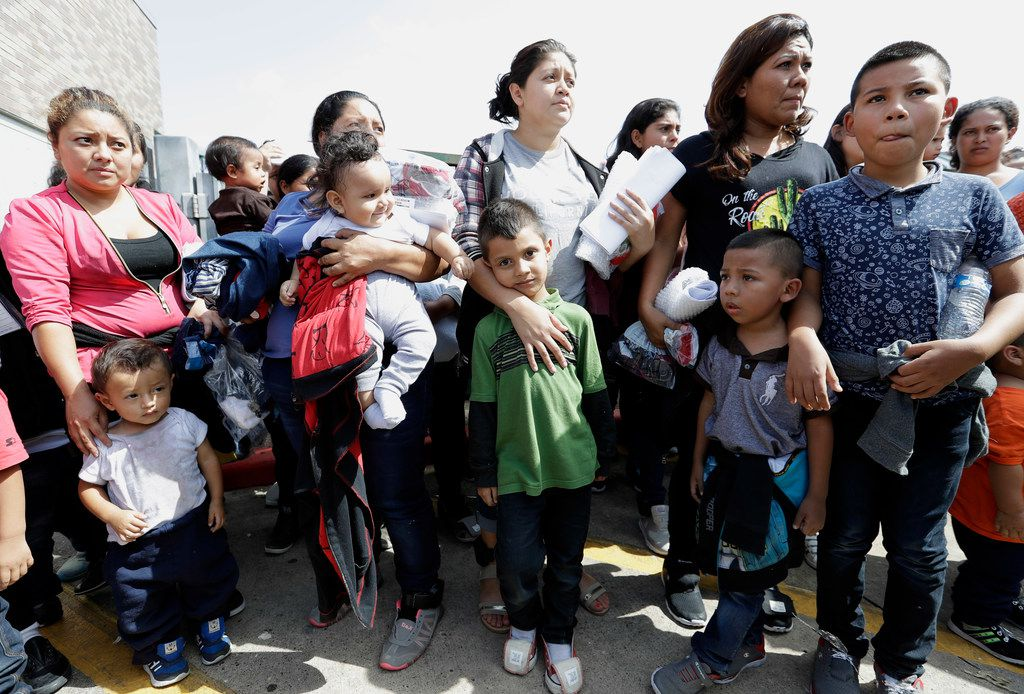 Immigrant women and children wait to enter the bus station after they were processed and released by U.S. Customs and Border Protection, Friday, June 22, 2018, in McAllen, Texas.