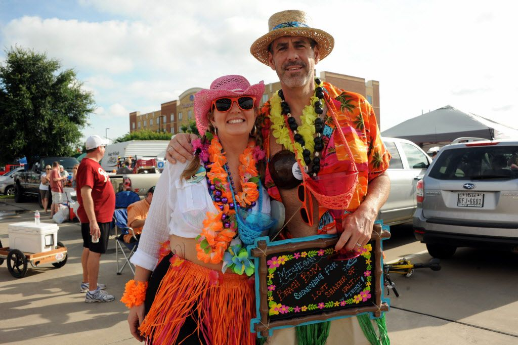 Fans from Michigan party at the Jimmy Buffett tailgate at Toyota Stadium in Frisco, TX on May 30, 2015.