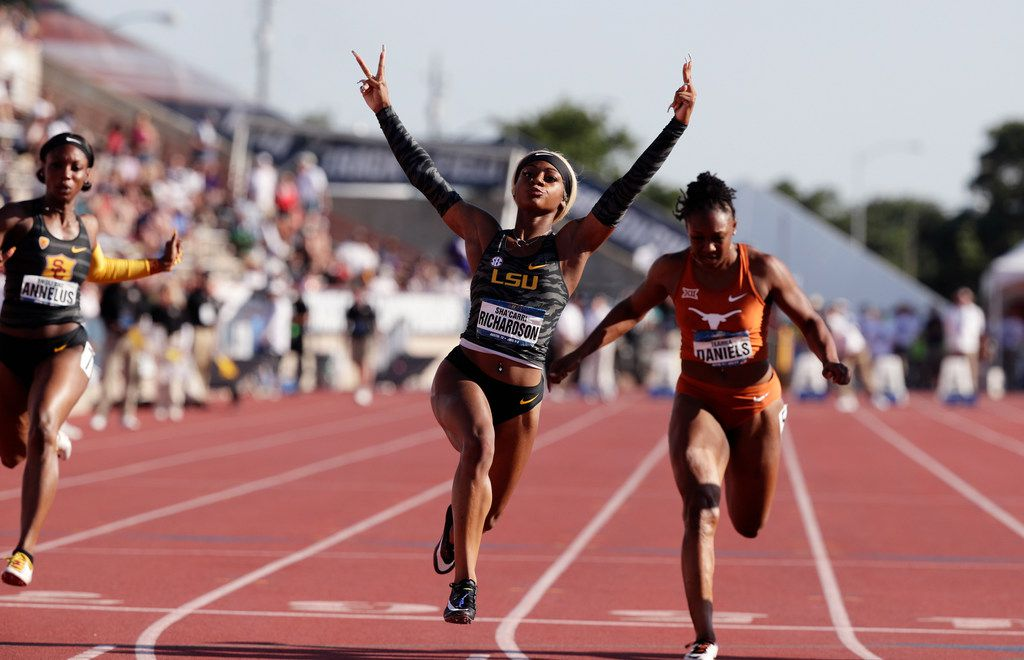 LSU's Sha'Carri Richardson (center) celebrates as she wins the women's 100 meters during the NCAA outdoor track and field championships in Austin, Texas, Saturday, June 8, 2019. (AP Photo/Eric Gay)