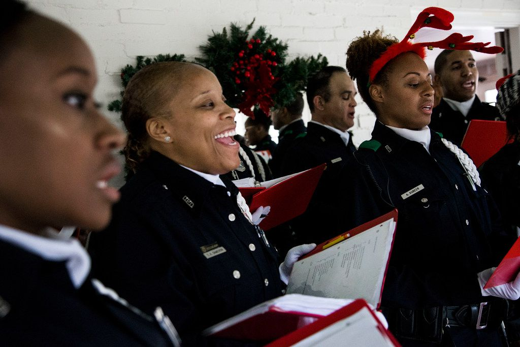 From left, Dallas police officers Sasha Kim, Tamika Dameron and Anna Kubeer, all of the Dallas Police Choir, warm up before performing at Richardson Woman's Club on Dec. 6, 2018. The Choir is kicking-off their 2018 Christmas Tour performing at hospitals, assisted living centers and other businesses.
