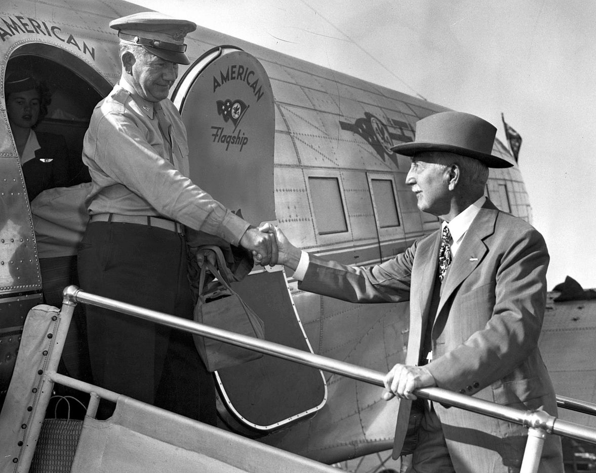 E. M. Ted Dealey is greeted by his father G.B. Dealey upon his arrival home from the signing of the peace treaty with Japan, Sept. 18, 1945.