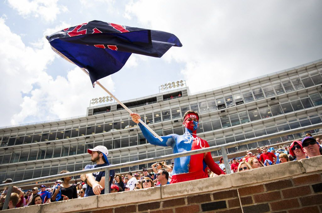 SMU fan Kyle Skipper waves an SMU flag from the stands during the first half of their spring football game on Saturday, April 18, 2015 at Ford Stadium in Dallas, Texas. (Ashley Landis/The Dallas Morning News)