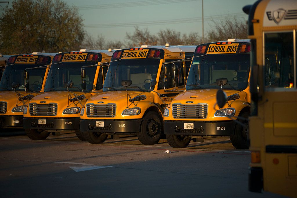 Dallas Independent School District school buses parked at the district's bus lot